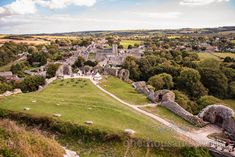 Landscape countryside view over Corfe village from Corfe Castle wedding venue by one thousand words wedding photographers Corfe Castle, Wedding Venues, Wedding Day, Countryside, Photographers, Dolores Park, Landscape, Travel, Wedding Reception Venues