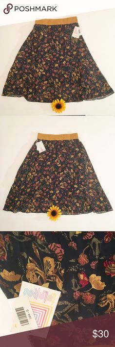 Floral tan/beige LuLaRoe Lola skirt NWT small NWT small LuLaRoe Lola skirt. Fun mix of colors. Tans, beige, blue, and maroon. Comfortable stretchy waist. Let me know if you have any questions! LuLaRoe Skirts Asymmetrical