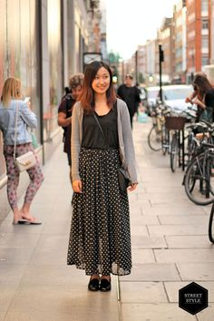 Angu breaks up her spotted pattern and kept it simple by pairing her H&M spotted skirt with a black t-shirt on top. Her black paint-ent flats and leather cross bag give the look an added touch of class. #blackballad #streetstyle #fashion
