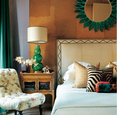 {sk} Note:  I love the nailhead detail on the headboard.  This picture also shows how to easily update a room with a color trend change {lamp, mirror, drapery detail} I've been on the Emerald Green kick for a while.