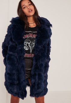 Sick coat seeks babe. This gorg navy blue bubble faux fur coat will give you all the fierce vibes you need to rule the world!
