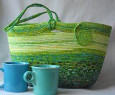 Eyecatching green batik coiled fabric basket by BatikBaskets on Etsy https://www.etsy.com/listing/215114915/eyecatching-green-batik-coiled-fabric