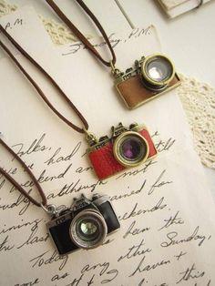 camera necklaces. LOVE.
