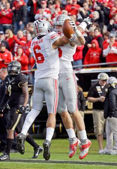 Ohio State tight end Jeff Heuerman, right celebrates with wide receiver Evan Spencer after scoring a touchdown against Purdue. (Michael Conroy/AP)
