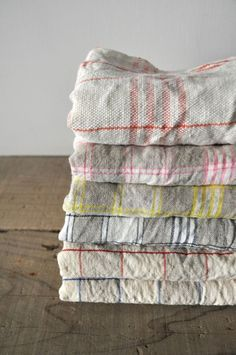 ALDIN tea towels at Classico. Shows textures of the textiles, nice balance of colors & pattern, off to the right on the wooden floor. Textiles, Textile Patterns, Tea Towels, Linen Towels, Dish Towels, Paper Towels, Linen Napkins, Linens And Lace, Deco Table