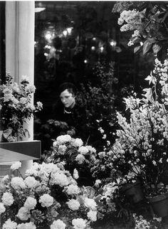 Brassaï, At the florist's, Paris, 1930's  http://tamburina.tumblr.com/post/87362480983/brassaï-at-the-florists-paris-1930s