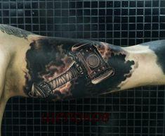 Realism tattoo on forearm by Dmitriy Schelokov