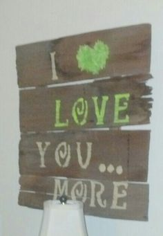 Simple sign made of old cedar shingles, letter stencils, and tissue paper for the heart