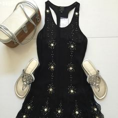 """HPP & S, WG  Kate Moss for TopShop Dress Gorgeous T-back halter dress by Kate Moss. Dress is beaded & rhinestone studded. The dress is sheer so would need to wear a long tank or slip underneath. Dress is 100% Viscose and can be hand washed & line dried. NWT & has a large pack of extra beads & studs. UK 6, US 2 but runs more like a 0-2 depending on your bust. Measures 15.5"""" across bust laying flat & is 32"""" from neck to scalloped hem. Topshop Dresses Midi"""