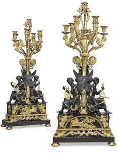 A PAIR OF EMPIRE ORMOLU AND PATINATED BRONZE SEVEN-LIGHT CANDELABRA ATTRIBUTED TO CLAUDE GALLE, CIRCA 1805