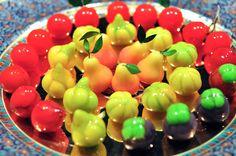 Originally for Thai royals, these sweet mung bean cakes are shaped into fruits and glazed for a shiny finish