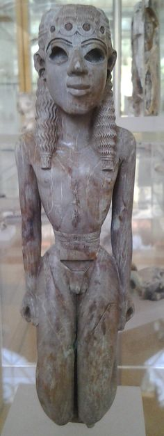 7th century BC ivory figurine of a kneeling youth, probably part of a musical instrument. Archaeological Museum of Vathi on Samos (Greece)