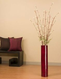 25 in. Red Bamboo Floor Vase and Ivory Florets by Green Floral Crafts. $49.99. On a scale of 1 (easy) to 5 ( for the crafty types), this arrangement is a 2.. Delicate ivory florets are handcrafted from tree leaves and set on coconut stems. Striking combination of dark red vase with ivory florets brings a splash of elegant color to any room. Ivory florets shows best against lightly tinted wall background or very white wall color. Tall cylinder floor vase 25 in. H x 5 diameter is h...
