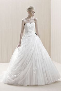 """Brides.com: . """"Enschede"""" strapless lace and tulle ball gown wedding dress with a sweetheart neckline, Blue By Enzoani"""
