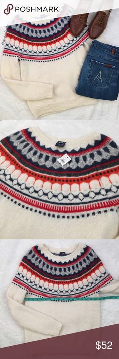"""NWT Gap Fair Isle Circular sweater Gorgeous sweater for fall and winter! 🍂🌬❄️ Lovely pattern around the neck and chest in orange, navy, grey and red. Body is a light cream color. New with tag. Made from 47% nylon, 20% acrylic, 20% mohair & 13% wool. Measures 17"""" across the chest and 25"""" from shoulder to hemline. Please ask any questions prior to purchasing. *Listing for sweater only. 7FAM pants available in separate listing. GAP Sweaters Crew & Scoop Necks"""