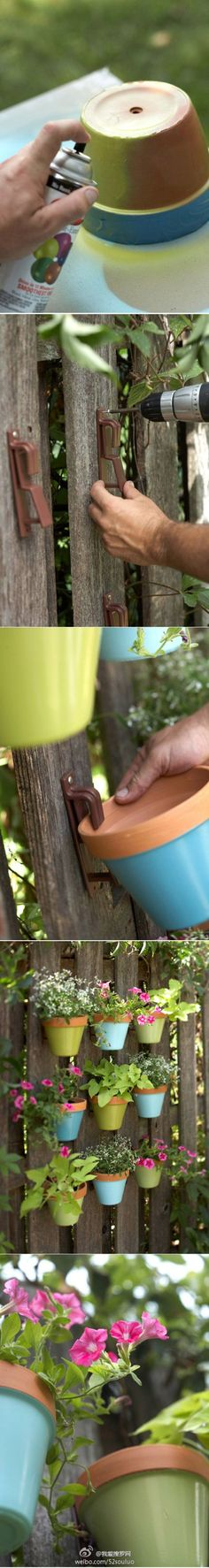Decorate a fence with hanging flower pots painted for lots of color and life. Project published in Better Homes and Gardens.