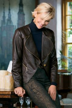 Exposed antiqued gold metallic zipper detail gives this expertly distressed leather-like jacket a modern edge in more ways than one. Front a...