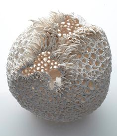 Irish Nuala O'Donovan is a sculptural ceramist fascinated by geometric irregularities in nature. Each piece is composed of delicate porcelain elements, which she creates over several weeks in response to the organic material and the random events of creation – literally sculpting an exquisite order out of chaos.