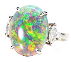 In my childhood I begged my Grandpa Jones to make me a black opal ring.  So he did.  I was heartbroken when I found out it was fake.  Now I understand why I didn't get a real one:  Symphony of Color: Black Opal Diamond Ring