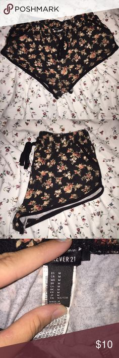 "Comfy Floral Forever 21 Shorts These shorts are super comfy and perfect for a day on the beach or a night in watching movies. They are in great condition! I am 5'7"" and they were a bit short on me. Forever 21 Shorts"