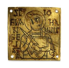 A ninth-century Anglo-Saxon gold plague with a zoo-anthromorphic symbol of St John the Evangelist, with eagle head and human hands holding a book (symbol of his Gospel). (British Museum)