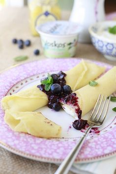 Easy and Healthy Lemon Crepes with Blueberry Sauce. Made with Greek yogurt and lemon curd. Yummy Mummy Kitchen.
