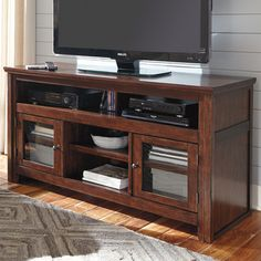 Signature Design by Ashley Harpan TV Stand, wrong color, but I like the 3 tiers.