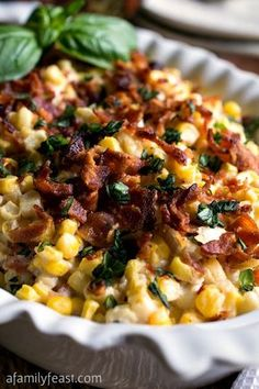 Corn and Bacon Casserole - Fresh corn kernels and bacon in a light and creamy sauce that has been flavored with garlic and basil. So good!