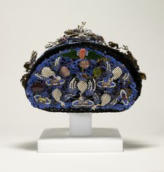 Ceremonial Headdress likely worn by the Empress Dowager Cixi, of the Manchu Yehnara clan. The small phoenixes emerging from the surface represent the Empress