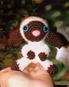 It came out so cute!  I used embroidery floss to make the nose and eyes.  Baby Lamb - CROCHET