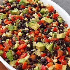 This fabulous Mexican Bean Salad recipe is great for entertaining because it is festive and you can make it ahead of time.
