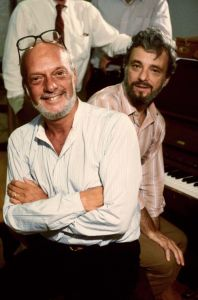 "From post on pics by Martha Swope  https://newyorktheater.me/2017/01/13/rip-photographer-martha-swope-40-years-of-broadway/  Director Hal Prince & composer Stephen Sondheim in a rehearsal shot fr. the Broadway musical ""Merrily We Roll Along""."