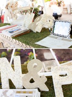 Guest Book table decorations with embellished initials... Image: Carrie Butler Photography