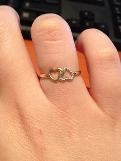 White gold and yellow gold interlinking hearts ring