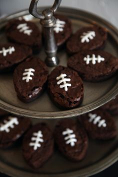football brownies...cool idea for one of the boys birthday parties instead of a cake...;-)  I would frost these with a ganache so they wold look smoother...