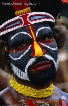 Portrait of man in tribal face paint at Enga.  Wabag, Enga, Papua New Guinea