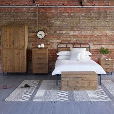 Baxter Round Industrial Wardrobe. Our versatile Baxter wardrobe, made from reclaimed pine and antiqued metal, combines an industrial feel with a simple design, offering a focal point for your bedroom.