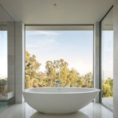 Soaking Tub with a View Tagged: Bath Room and Freestanding Tub. Photo 13 of 22 in Minimal House One by Tooke Architects, Inc. Bath Window, Bathroom Windows, Bathroom Interior, Modern Bathtub, Modern Bathrooms, White Bathrooms, Luxury Bathrooms, Master Bathrooms, Dream Bathrooms