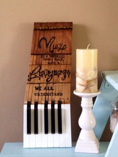 Piano keys art reusing antique keys as an art canvas for the quote- Music is a world within itself with a language we all understand by MusicAsArtBySarah on Etsy