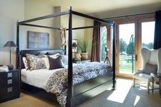 Master bedroom with huge windows opening out to the back
