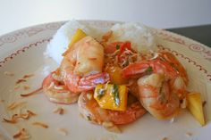 Spicy Mango Shrimp ~  Shrimp swimming in a mango and sweet chili sauce, these scrumptious morsels of goodness are heaven. The sweet tropical flavor of mango enhances shrimp the way no other fruit can. Add some soy sauce and some sweet chili sauce, spoon it over steamed rice and you've got the perfect dinner.
