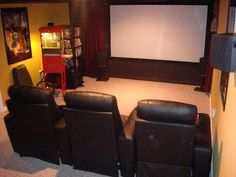 ideas for converting garage into a budget friendly home theatre room… must have popcorn machine!