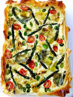 What do you do with a bunch of asparagus, some artichoke hearts, a handful of fava beans, a leek and a few cherry tomatoes? You make a tart of course! I always buy a pound or two of ricotta every week