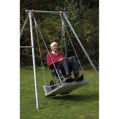 The wheelchair platform and single swing frame from TFH enables wheelchair users of all ages to safely enjoy the emotional and physical benefits of playing on a swing. Sensory Swing, Sensory Garden, Sensory Toys, Indoor Swing, Porch Swing, Swing Set Kits, Sensory Integration Therapy, Platform Swing, Single Swing