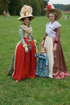 The blue and red on this gown is lovely. As are those hats!