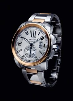 Cartier Calibre watch in steel and pink gold.