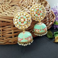 A pair of golden-toned Traditional Floral Hand Painted Meenakari Sea Green Jhumka Earring for Women. This Lightweight dome Shaped Meenakari Earrings with Indian Bridal Jewelry Sets, Indian Jewelry Earrings, Bridal Bangles, Ear Jewelry, Antique Earrings, Jhumkas Earrings, Tikka Jewelry, Chunky Jewelry, Temple Jewellery