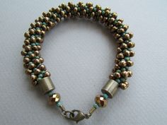 This kumihimo bracelet is made from turquoise picasso Miyuki seed beads and bronze colored magatamas with antique brass cones and lobster claw clasp. This bracelet is approximately 9 in length and will fit up to an eight inch wrist. Please let me know if you would like this bracelet in a different size