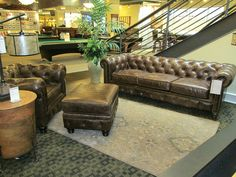 Beautifully textured leather with tufting and antiqued nail heads brings out the character of this sofa, chair and ottoman set. It has the look of an antique piece, but with the durability to withstand many years of use.
