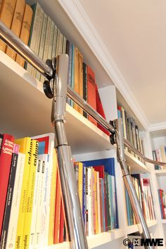 Special constructed VARIO telescopic library ladder with AUTOSTOP-FUNCTION, finished with high glossy polishing!